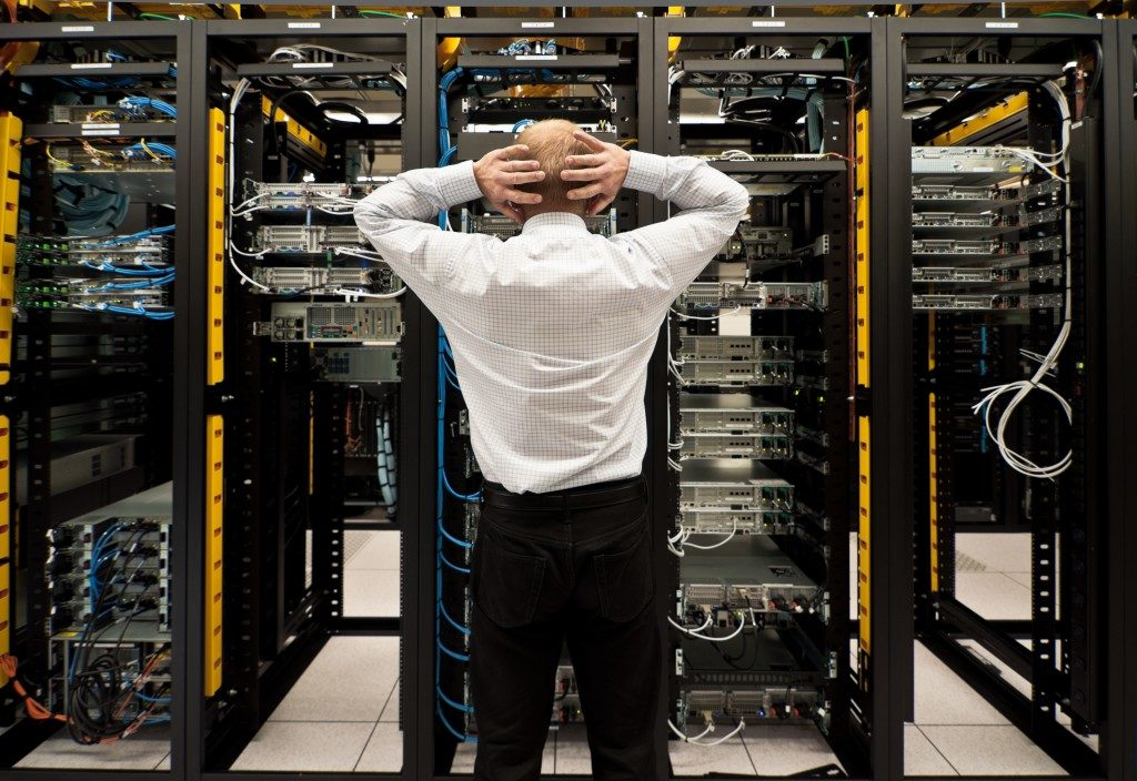 Frustrated employee looking at a network data center