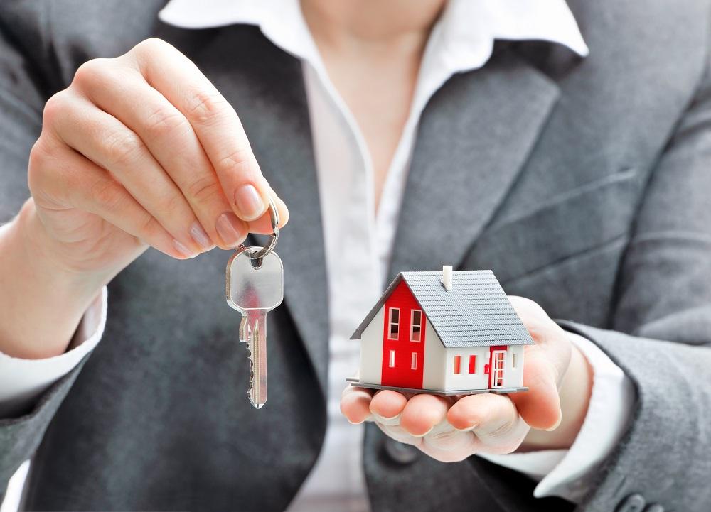 broken holding house and keys real estate concept