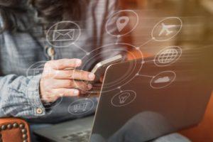 woman using technology to maximize business process