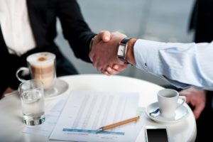 Businessman and client handshake