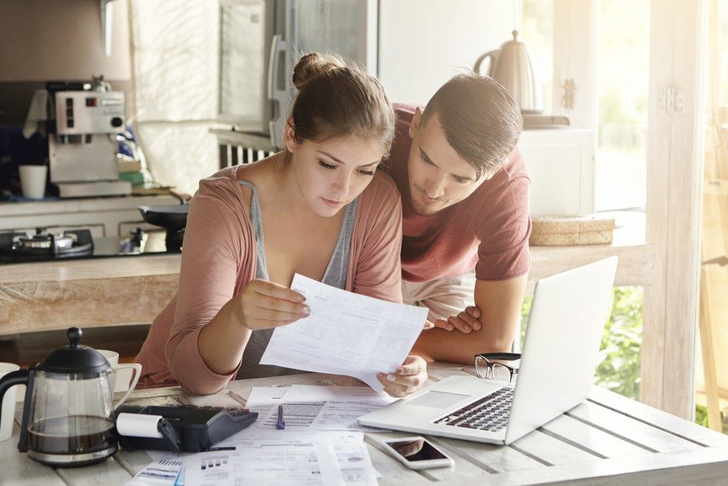 couple checking their bills