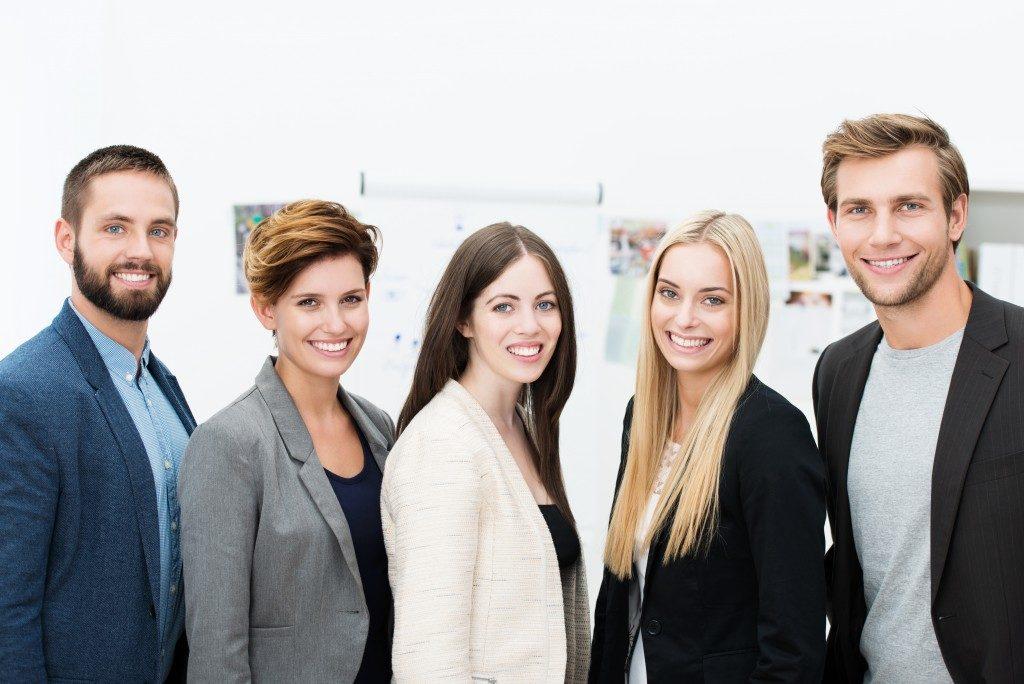 Marketing team posing for the camera