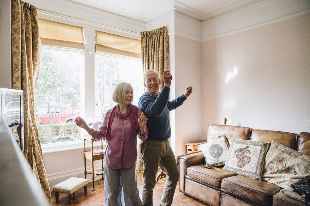 Seniors dancing in the living room