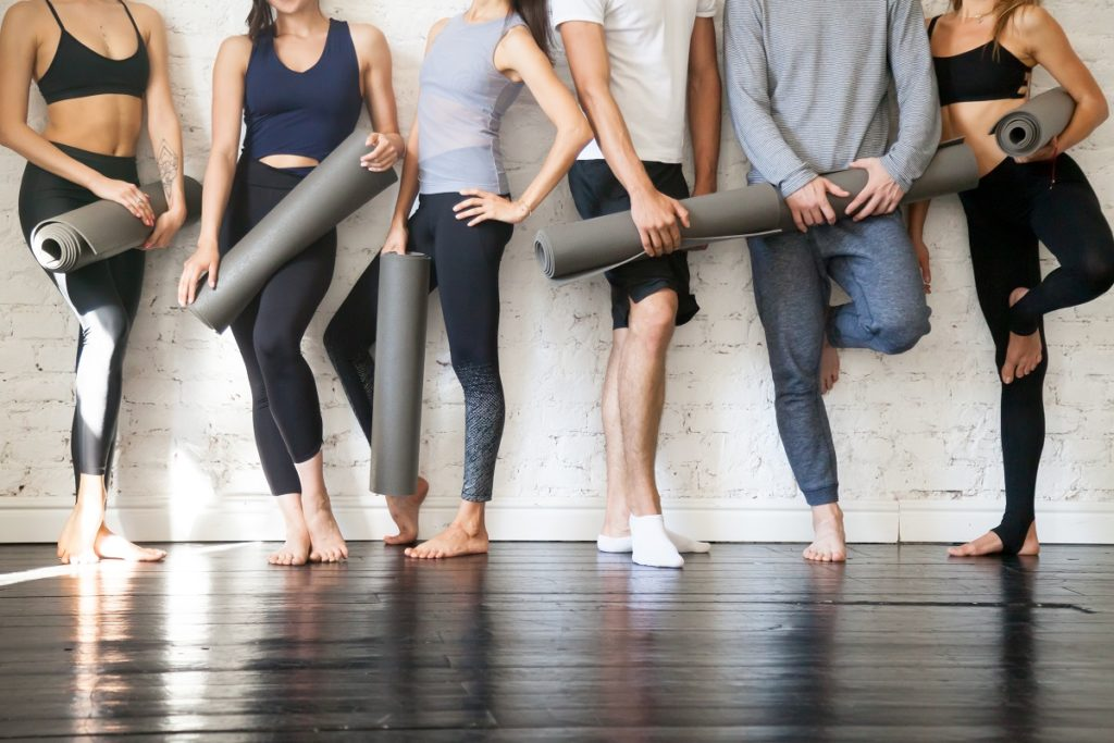 group of people in yoga attire posing