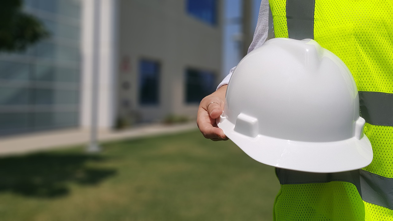 man holding a hard hat