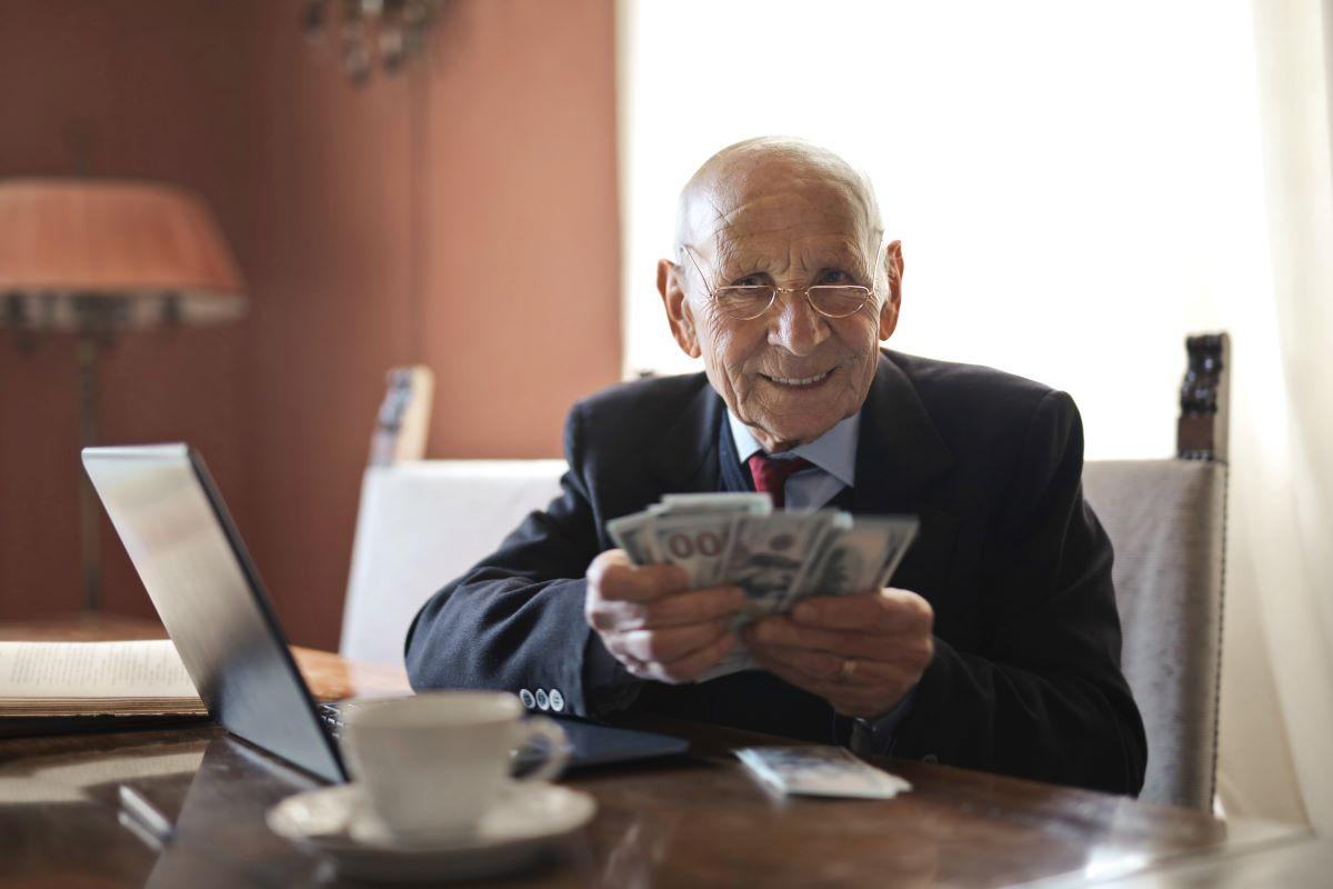 elder man holding money