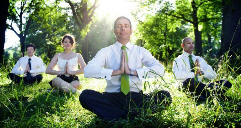 business employees meditating