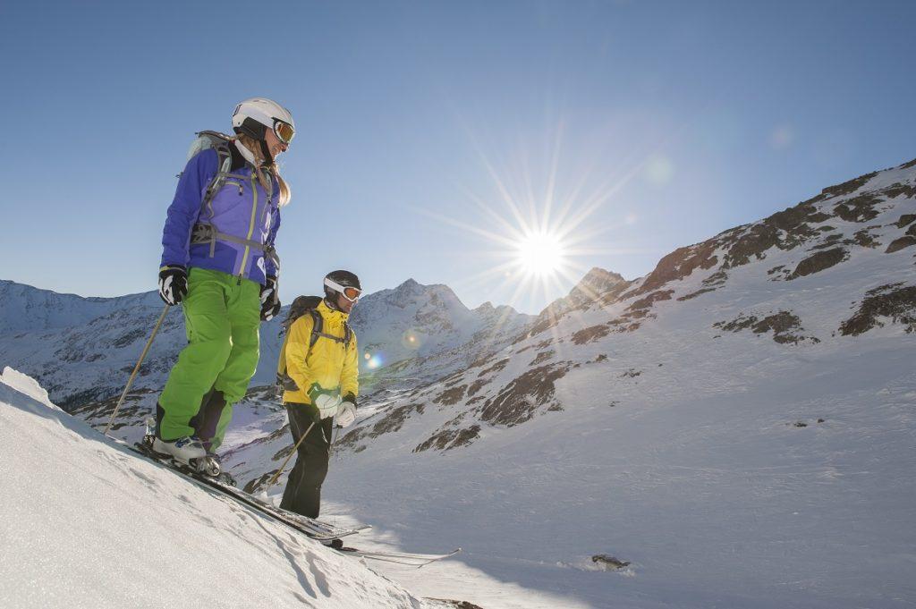 two skiiers