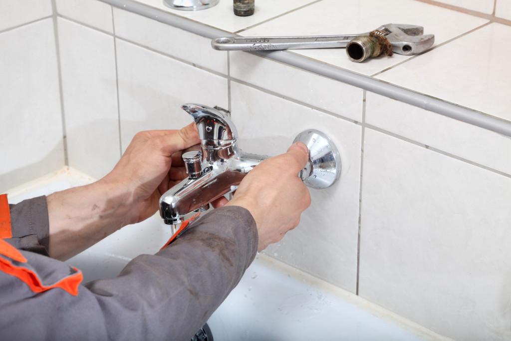 plumber fixing faucet