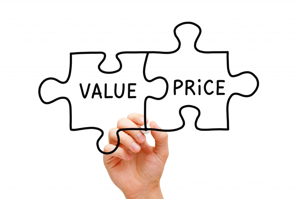 hand drawing value and price as puzzle pieces